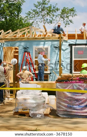 Former President Jimmy Carter, helping build houses for Habitat for Humanity
