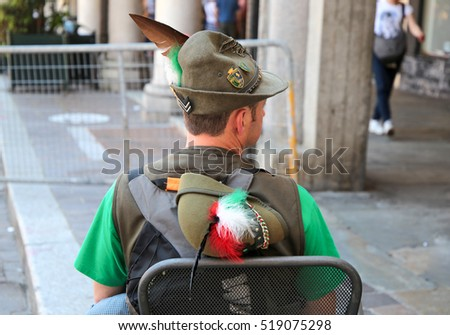 Former soldier sitting and showing his back during a military Italian national meeting