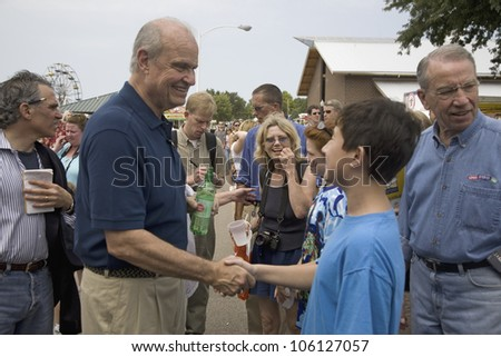 Former U.S. Senator and actor of Law & Order, Fred Thompson shaking boys hand and U.S. Senator, Chuck Grassley, at Iowa State Fair to campaign for U.S. President, August 17, 2007, Des Moines, Iowa