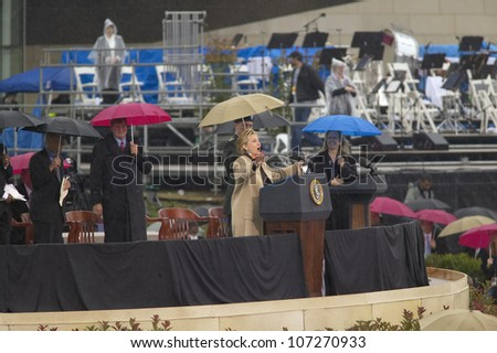 Former US First Lady and current US Sen. Hillary Clinton, D- NY speaks during the grand opening ceremony of the William J. Clinton Presidential Center in Little Rock, AK 18 November 2004. - stock photo