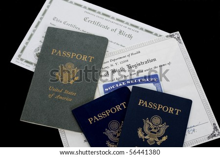 Forms of identification are arranged on a black background