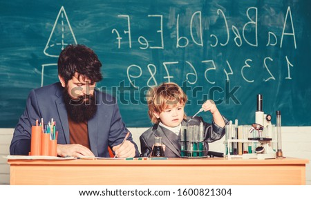 Formula. experiments in organic chemistry laboratory. small boy with teacher man. Wisdom. Back to school. son and father at school. biotechnology research concept. Education engages a man
