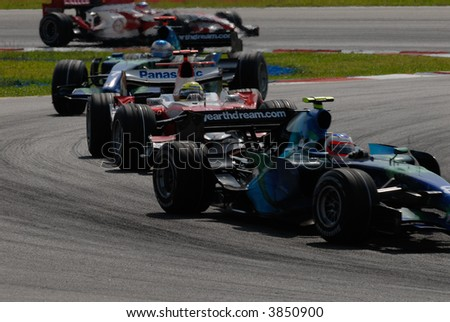 Formula One cars racing at F1 PETRONAS Grand Prix Sepang Malaysia 2007