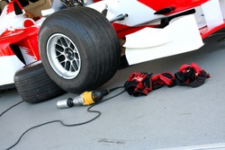 Formula-1 racing pit-stop devices
