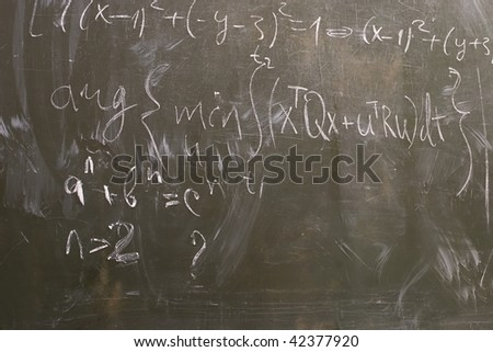 Formulas written on the board, education background.