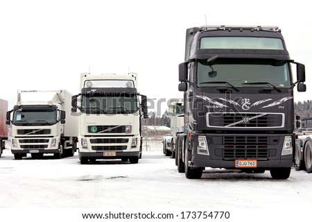 FORSSA, FINLAND - JANUARY 25, 2014: Group of Volvo trucks in winter conditions. Volvo Trucks has developed a system known as Stretch Brake that significantly improves safety for slippery winter roads.