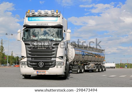FORSSA, FINLAND - JUNE 13, 2015: Scania R620 Tank truck leaves truck stop. Scania\'s market share in Europe reached a record high 17.2 percent during the first half of 2015.