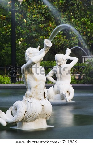 Forsyth Park Fountain in Savannah Georgia.  Showing the mermen. - stock photo
