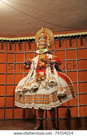 FORT COCHIN - MARCH 06: Kathakali performer in the virtuous Lalitha role on March 06, 2011 in Cochin Kathakali  Center, South India. Kathakali is the ancient classical dance form of Kerala.