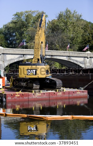 FORT EDWARD, NY- SEPT 26: Dredging Crane cleans around bridge Piers during PCB cleanup in the Hudson River, SEPT 26, 2009 in Fort Edward, NY.