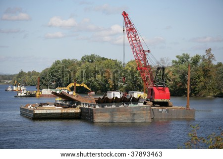 FORT EDWARD, NY- SEPT 26: Dredging equipment line the river above Ft. Edward during PCB cleanup in the Hudson River, SEPT 26, 2009 in Fort Edward, NY.