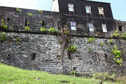 Fort George hilltop fortress walls and battlements in St. George's on the Caribbean Island of Grenada.