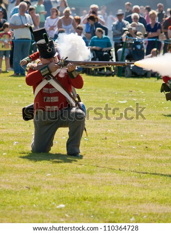 FORT GEORGE, SCOTLAND - AUGUST 11: An unidentified actor in Redcoat costume entertains the crowds at the annual Celebration Of The Centuries event on August 11, 2012 at Fort George, Scotland.