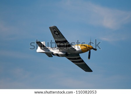 "FORT GEORGE, SCOTLAND - AUGUST 11: An unidentified pilot flies the P-51D Mustang plane ""Ferocious Frankie"" at the Celebration Of The Centuries event on August 11, 2012 at Fort George, Scotland."