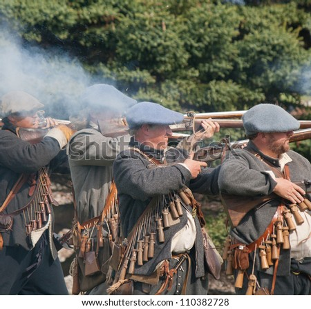 "FORT GEORGE, SCOTLAND- AUGUST 11 : Unidentified actors firing rifles during the annual ""Celebration of the Centuries"" event at Fort George, Scotland, August 11, 2012"