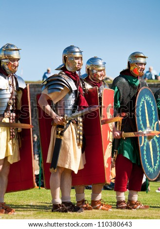 FORT GEORGE, SCOTLAND - AUGUST 11: Unidentified actors in Roman costume entertain the crowds at the annual Celebration Of The Centuries event on August 11, 2012 at Fort George, Scotland.