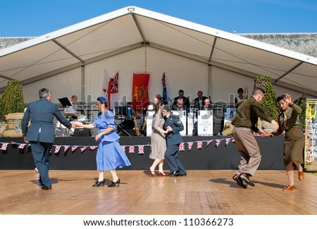 FORT GEORGE, SCOTLAND - AUGUST 11: Unidentified actors in 1940's costume entertain the crowds at the annual Celebration Of The Centuries event on August 11, 2012 at Fort George, Scotland.