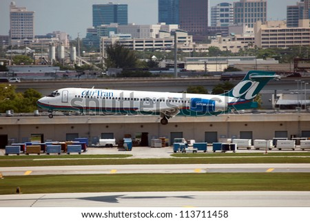 FORT LAUDERDALE, FL - MAY 10: An AirTran Boeing 717 on approach on May 10, 2012 in Fort Lauderdale, FL. AirTran is a subsidiary of Southwest Airlines. It operates with 140 planes.