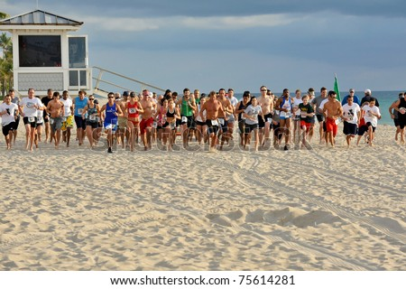 FORT LAUDERDALE, FLORIDA - APRIL 16: Competitors starts to run in the 5K Barefoot Marathon in Fort Lauderdale April 16, 2011.