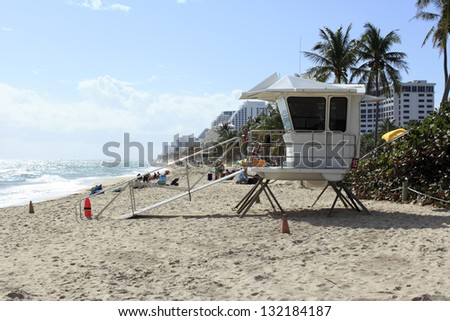 FORT LAUDERDALE, FLORIDA - NOVEMBER 18: Lifeguard tower 15 with many people on the beach enjoying the beautiful, sunny and warm autumn day on November 18, 2012 in Fort Lauderdale, Florida.