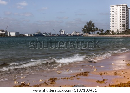 Fort Lauderdale, Florida/USA - April 15, 2018: Image is of the Jetty and Sea Port in Fort Lauderdale, Florida.  Many commercial and recreational boats enter and exist this sea port. #1137109451