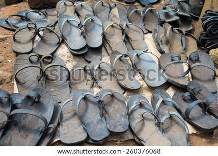 FORT PORTAL, UGANDA -- JUNE 05 2013 : Traditional african tire shoes in traditional african market. June 05, 2013, Fort Portal, Uganda.