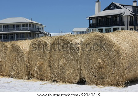 FORT WALTON BEACH, FL - MAY 9: Hay bales on white sand beach ready for BP oil spill cleanup May 9th, 2010, in Fort Walton Beach, FL.