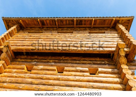 fort wooden high log wall old windows background sky tradition europe protection of the city