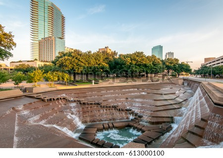 Fort Worth, Texas Water Gardens. Downtown public park and architectural image. Rushing water over the concrete structures. Summer day in the city.