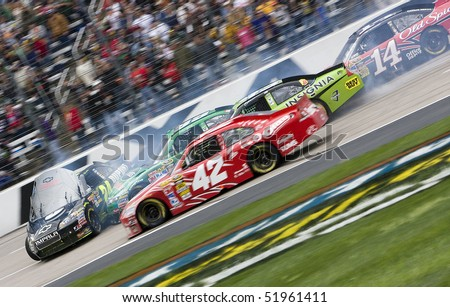 FORT WORTH, TX - APR 19:  A multiple car wreck brings out a red flag at Texas Motor Speedway during the running of the Samsung Mobile 500 race Apr 16, 2010 in Fort Worth, TX.