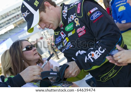 FORT WORTH, TX - NOV 05:  Carl Edwards (99) takes time out to sign some autographs before qualifying for the AAA Texas 500 race on NOV 5, 2010 at the Texas Motor Speedway in Fort Worth, TX.