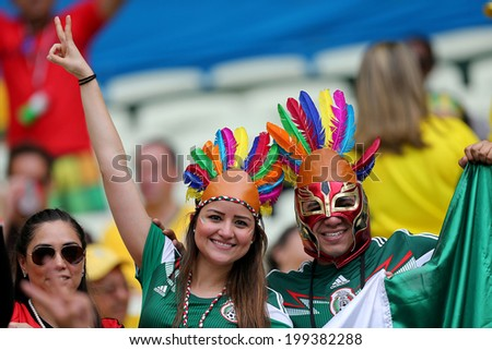 FORTALEZA, BRAZIL - June 17, 2014: Fans celebrating during the World Cup Group A game between Brazil and Mexico at Estadio Castelao. No Use in Brazil.  #199382288