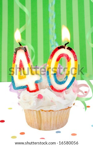 fortieth birthday cupcake with white frosting and green decorative background