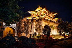 Fortification wall and south gate of Dali old town illuminated at night in Dali Yunnan China