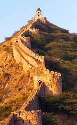 fortification with bastions of Jaigarh fort and Amer or Amber town  near Jaipur city India evening view