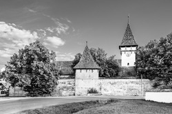 Fortified evangelical church of Cincsor village near Fagaras in Brasov county, Transylvania, Romania; Traditional saxon fortified church of Transylvania in black and white