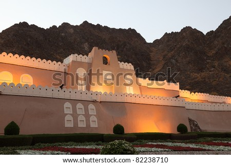 Fortified gate to Muttrah at night. Muscat, Sultanate of Oman