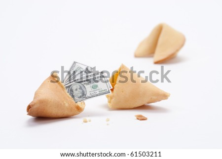 Fortune cookie broken open with miniature cash coming out
