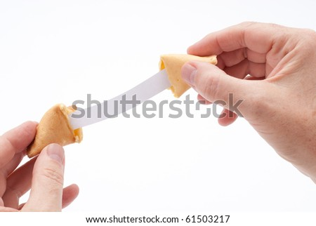 Fortune cookie held open to reveal extra long blank fortune