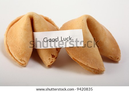 "fortune cookie with text: ""good luck""."