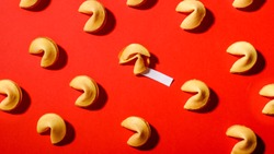 Fortune cookies on a red background, close-up.Сookies with prediction, pattern.