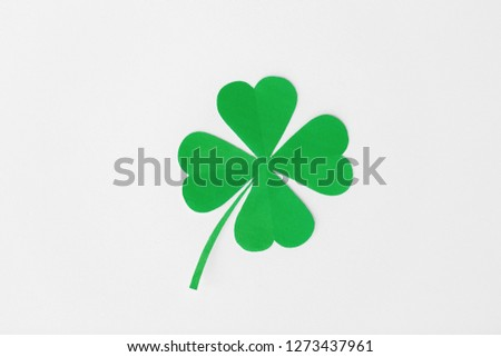fortune, luck and st patricks day concept - green paper four-leaf clover on white background #1273437961