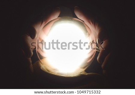 Fortune teller reading future with crystal ball. Seance concept. #1049715332
