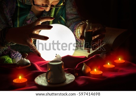 Fortune teller woman staring at crystal ball,potion and witchcraft #597414698