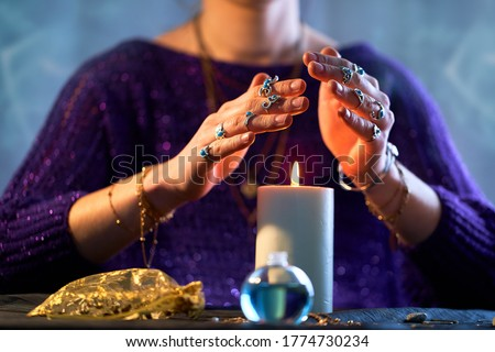 Fortune teller woman using burning candle flame for spell, witchcraft, divination and fortune telling. Spiritual esoteric occult magic ritual illustration