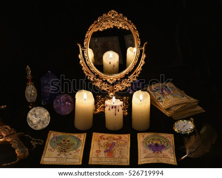 Fortune telling ritual with the Tarot cards, mirror, crystals and vintage objects. Halloween concept, black magic still life or witch spell with occult and esoteric symbols, divination rite. #526719994