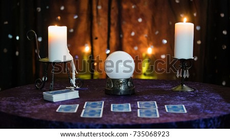 Fortune Telling Table with a crystal ball and tarot cards