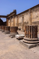 Forum of Pompeii with pieces of columns from Basilica. Ruins of an ancient city destroyed by the eruption of the volcano Vesuvius in 79 AD, Pompeii, Naples, Italy