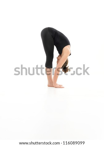 forward bending yoga pose, shown by younf female, dreesed in balck, on white background, side view