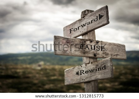 Forward, pause, rewind signpost in nature. Move forward, future, signs, wild, life concept. #1312815773